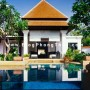 An exquisite bungalow is reflected in the adjoining swimming pool